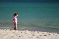 A girl in pink at the beach (Hopeisland) Tags: