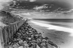 Rosslare Strand (movinonagroove) Tags: longexposure ireland sky blackandwhite sunlight seascape beach grass clouds strand photoshop canon sand rocks eire posts rosslare groynes canon1740mmf4 cs6 rosslarestrand leefilter canoneos5dmarkii bigstopper silverefexpro2