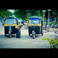 339/365. What's He Upto? (Anant N S) Tags: auto street portrait india vintage photography 50mm streetphotography rick stranger faux nikkor rickshaw vignette pune aundh rickshawdriver project365 portraitofastranger nikond3000 rickshawpune lensor anantns thelensor anantnathsharma rickshawdriverindia