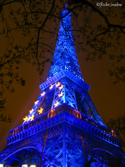 Eiffel Tower Side View (Marina BW) Tags: city blue sky paris france tree tower metal horizontal architecture night skyscraper outdoors photography cityscape arch eiffeltower nopeople illuminated sideview capitalcities traveldestinations colorimage famousplace buildingexterior internationallandmark frenchculture marinabwfs