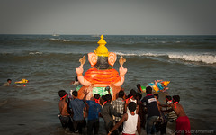 Another Year Goes By.. (sunil.subramanian) Tags: ocean people india love water colors festival festive children ganesha nikon mud respect religion joy culture police cranes transportation future passion bye tomorrow crowds tamilnadu idols immersion introspect d90 nikond90 sunilsubramanian