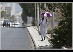 Too Hot (Dune_UK) Tags: street man hot umbrella walking j photo haze photographer image kingdom photograph heat saudi arabia jeddah too glynne pritchard ksa jiddah