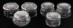 1023. Six Sterling Lidded Glass Dresser Jars
