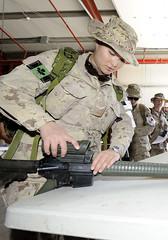 OP ATHENA (www.combatcamera.forces.gc.ca) Tags: camera woman afghanistan vertical female women uniform canadian combat forces kandahar isaf afgtav11