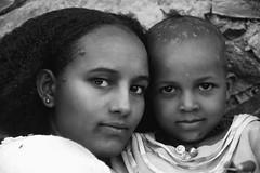 Tigray Sisters (Rod Waddington) Tags: africa african afrika afrique adigrat ethiopia ethiopian ethnic etiopia ethnicity ethiopie etiopian thiopien tigray blackandwhite sisters girls female rock wall traditional orthodox