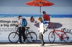 On The Beach (Timm Ranson) Tags: burystedmunds station suffolk streetphotography socialdocumentary digital alpha900 sony timmranson facebook picfair bikes cyclist cycling beach coast hoarding advert people sit sitting seated