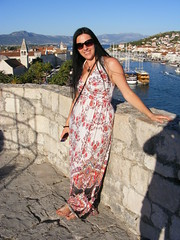 Nina - Queen of the Castle  - Kamerlengo Trogir (sean and nina) Tags: necklace neck teeth nina kamerlengo castle fort fortification stone wall sea ocean adriatic water boats sailing vessels ships town trogir croatia croatian serb hrvatska coast beauty beautiful gorgeous stunning cute charm charming woman female girl lady girlfriend fiancee wife married long dark hair brunette white dress handbag mobile phone mouth bare arms skin hands tan tanned face balkans balkan holiday vacation visitor standing pose posed posing smile smiling happy view panorama sandals feet toes sunshine