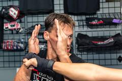 Slipping a Punch (Daniel Medley) Tags: krav maga reborn utah salt lake city fight punch spar sport gym yongnuo 560 iii nikon d5200