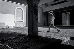 Walking Girl (Gerald Verdon) Tags: leica copyright portugal girl walking dress noiretblanc lisbon rangefinder fav20 strip m8 gesture skopar fav10 geraldverdon