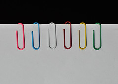 Held together [Explored] (Bhaskar Dutta) Tags: paper unity clips together contact held reminder bound hold integrity