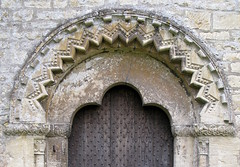 Late Norman north doorway (c.1180), the Church of St Mary, Bibury, Gloucestershire, England (detail) (Hunky Punk) Tags: uk england head mary gothic churches arches cotswolds medieval gloucestershire norman mold mould romanesque plain middleages beaded doorways saxon trefoil palmleaf bibury chevrons dogtooth tympanum hunkypunk billeted spencermeans