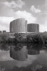 Reflections (Saturated Imagery) Tags: blackandwhite reflection slr film monochrome 35mm river canal apartments yorkshire leeds riveraire microphen aireandcaldernavigation luckyshd100 luckyshd vivitar28mmf25 ilfordmicrophen prakticatl5b film:iso=100 developer:brand=ilford developer:name=ilfordmicrophen film:brand=lucky film:name=luckyshd100 filmdev:recipe=8021