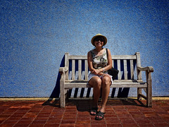 Lady on Bench (crowt59) Tags: park blue wall lady bench lumix dallas texas fair zs3