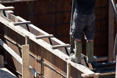 Pouring a Foundation 7 (LongInt57) Tags: wood people canada man men work concrete person site workers construction bc legs employment jobs okanagan leg cement working vibrator valley forms worker form job jobsite sites jobsites