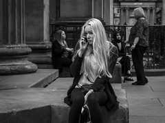 Degree of Sadness (Leanne Boulton) Tags: monochrome urban street candid portrait portraiture streetphotography candidstreetphotography candidportrait streetlife woman female face facial expression blonde mobile phone emotion feeling sadness tiredness sitting tone texture detail depthoffield natural outdoor light shade shadow city scene human life living humanity society culture people canon 7d 50mm black white blackwhite bw mono blackandwhite glasgow scotland uk