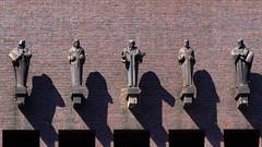 Protestant saints? (uneitzel) Tags: art backstein barmbek brick bugenhagenkirche church facade fassade hamburg kirche kunst mzuiko45mm olympusem5 sculpture skulptur ziegel statue shadow schatten