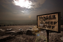 Danger - Keep Off (Jammer 1970) Tags: danger beach water sky clouds sign coast uk sussex worthing holiday vacation travel warning sun apocalyptic walkinddead zombie desolate faded peeling paint hazard pebbles rocks stones waves light vignette texture