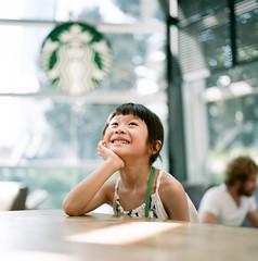 A Starbucks Dream. (MichelleSimonJadaJana) Tags: hasselblad 503cw 80mm f28 cfe carl zeiss planar medium format film analog 220 120 documentary lifestyle snaps portrait childhood children girl shanghai  china  jada jana