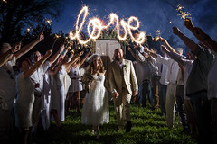 Lois and Pat's Wedding (Notley) Tags: httpwwwnotleyhawkinscom notleyhawkinsphotography notley notleyhawkins 10thavenue wedding sparklers weddingphotography people bride groom wed couple walk