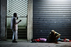 Agent Frustrateur (N A Y E E M) Tags: mother child beggar man cigarette smoke night light pavement footpath street dampara chittagong bangladesh availablelight carwindow