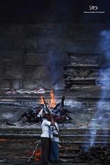 burning to ash. (Sreeram Nambiar) Tags: india burning funeral varanasi devotional kashi cultural ganga srm banares burningghat arati utterpradesh manikarnikaghat gangaarati sreeramnambiar sreeramnambiarphotography harischandraghat indiancoustume