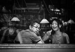 smile! you just been spotted :) (White_V) Tags: street city food woman man reflection london window glass smile canon restaurant glasses couple eating wb lamps 2012 whiteandblack