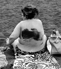 (Don Jackson) Tags: sea portrait people bw woman abstract black feet strange closeup lady female digital canon hair bag naked square eos back sand funny exposure sitting arms body mark fat side relaxing thoughtful photojournalism documentary surreal social towel mysterious unusual bazaar handbag journalism obese global voluptuous