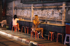 thai prostitute getting ready at Nana Plaza, Bangkok, Thailand (Igor Bilic) Tags: life road street ladies party girl bar night asian thailand bangkok candid chinese young documentary makeup prostitution thai tatoo redlight pattaya baht patpong nanaplaza
