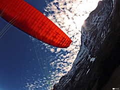 Paragliding Eiger North Face (Daniel Wildi Photography) Tags: sky snow mountains ice sports clouds switzerland paragliding 2012 berneseoberland gleitschirm eigernorthface cantonofbern visipix danielwildiphotography