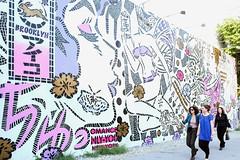 Lady Aiko wall at Houston & Bowery (damonabnormal) Tags: street city nyc newyorkcity people urban streetart graffiti stencil colorful fuji manhattan candid snapshot streetphotography september urbanart aerosol stencilart 2012 thebigapple urbanite x100 peopleinthecity ladyaiko fujix100 bowerywall thebowerywall