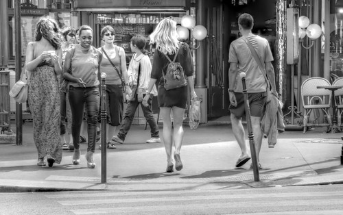 Some girls walking on a street.