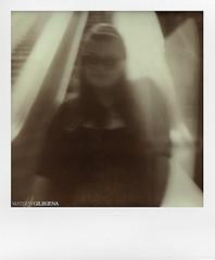 Danielle Underground (mgilbuena) Tags: sanfrancisco california blackandwhite woman white sepia stairs underground escalator bart danielle muni trainstation embarcadero marketstreet polaroidsx70 epsonv500 impossibleprojectpx100orangeflash