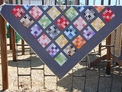 Paintbox Blocks Quilt (simple girl, simple life) Tags: pink blue red orange brown black color green wheel yellow modern rainbow picnic purple bright charcoal quilting 4square swirls patchwork simple kona primarycolors 4by4 dsquilts picnicandplaid
