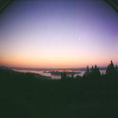 (MattieC.) Tags: city trees sunset sky sun canada film silhouette vancouver buildings lens lomo lomography bc view fisheye diana f