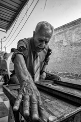 Backgammon player (Saman A. Ali) Tags: street streetphotography stphotografia blackwhite blackandwhite bw monochrome man people portrait teshouse backgammon outdoor fujifilm fujifilmxt1 fujinon16mmf14 documentary streetportrait game freetime retired