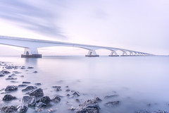 Overbruggen (xsgraphicdesign) Tags: bridge water stones sunset silky clouds sea