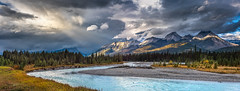 Magnificent Banff National Park (Ms Stacy) Tags: banffnationalpark canada river mountains water clouds sunrays rockymountains pano nature panorama