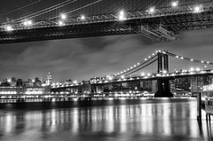 Twinkle Twinkle (DPGold Photos) Tags: nyc longexposure travel bridge blackandwhite bw usa ny newyork building skyline night docks river cityscape manhattan brooklynbridge manhattanbridge eastriver dpgoldphotos