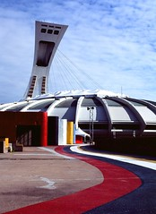 Olympic Stripes (Uporni tuljan) Tags: street city roof film colors architecture 35mm stadium montreal stripes wires suspended olympic curve olympiad