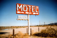 Motel Pool (Nick Leonard) Tags: old blue arizona sky classic film pool beautiful sign analog 35mm canon vintage outside outdoors route66 neon fuji desert gorgeous nick motel 200asa roadtrip brush scan retro 35mmfilm signage arrows fujifilm neonsign shrubs yucca timeless canont70 colorfilm epson4490 canonfilmcamera colorprintfilm walgreensbrandfilm nickleonard believeinfilm