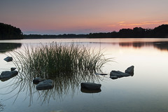 just another sunset (dK.i photography) Tags: longexposure sunset reflection glass grass twilight rocks glow maryland clear pinksky boyds blackhillregionalpark littlesenecalake 86seconds ef2470f28lusm canon5dmkii singhrayrgnd edwardkreis dkiphotography singhrayvarintrio
