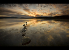 Stepping Stones (Michael~Ashley) Tags: sunset water clouds photography scotland nikon stones scottish calm stepping loch lochindorb d3100