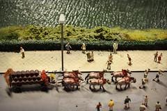 Miniature parade (ms holmes) Tags: street horses people berlin water river miniatures wasser leute pavement menschen parade sidewalk lantern fluss laterne pferde umzug figuren brgersteig fsser blasmusik gewsser strase miniaturen loxx miniaturwelten canoneos1000d