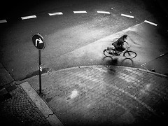 Curve (Jeff Krol) Tags: road street urban blackandwhite bw wet netherlands monochrome rain bike sign speed noir fuji cyclist ride noiretblanc wheels nederland streetphotography right rainy finepix fujifilm groningen curve blanc 2012 straat x10 4x3 straatfotografie bicucle jeffkrol fujix10 fujifilmfinepixx10 dscf276620120929