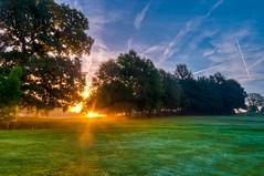 Here comes the sun..... (James Waghorn) Tags: light england sky mist tree clouds sunrise countryside sigma contrails ultrawide hdr sigma1020 d5000 bestofblinkwinners blinksuperstars