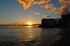 Sunset on the Beach (jcc55883) Tags: ocean sunset sky silhouette clouds hawaii nikon waikiki oahu horizon pacificocean hyatt hotels waikikibeach resorts royalhawaiian highrises outrigger moanasurfrider yabbadabbadoo d40 kalakauaavenue sheratonwaikiki kuhiobeachpark nikond40 waikikishoreline
