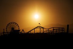 Santa Monica Pier (Aaron J Barber) Tags: santamonica pier rollercoaster wheel ferris amusementpark pacificpark pacific ocean beach mountain sunset glow silhouette sky shadow summer california usa america states flag starsandstripes