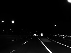 Chasin' the light, (World-viewer) Tags: racing zipping along art abstract night nightimage iphone iphone6 plus iphone6plus pov driving highway car auto automobile lights streetlights artistic strange weird fun interesting nice ngc vanishing point perspective windshield ineffable road bw blackwhite black white monochrome outdoor dystopia minimal minimalistic noir mood motorway bizarre cool hdr street streetphotos streetphotography photography stream lightstream light movement motion urban poetry zoom drive blackandwhite