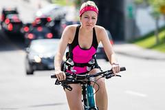 Cyclist in Pink (Dan Dewan) Tags: centretown portrait canon7dmarkii canonef70200mm14lisusm street 2016 colour  cyclist girl ottawa sunday summer pink woman august ontario photographist bankstreet lady face canon
