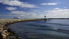 Travemnde 1 (jensfechter) Tags: travemnde ostsee baltic sea ship schiff lighthouse leuchtturm promenade meer wasser blau sonne steine strand mauer gelnder stones beach wall